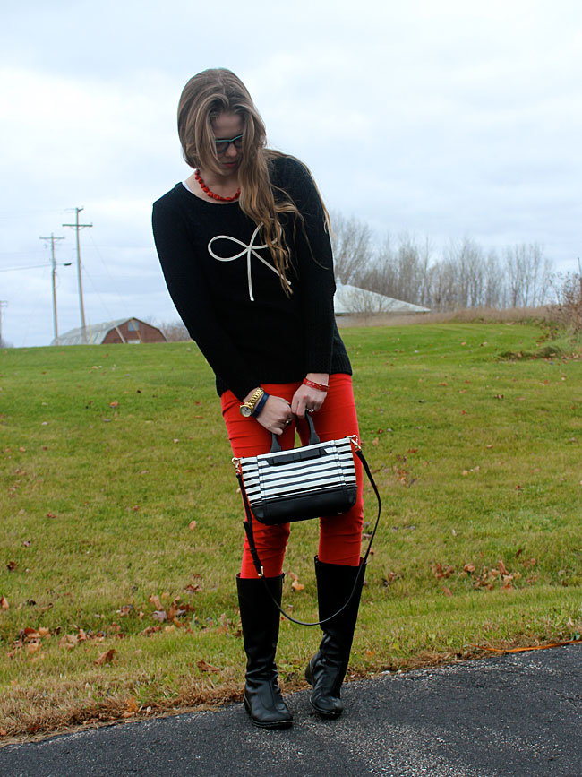 black-bow-sweater-red-pants