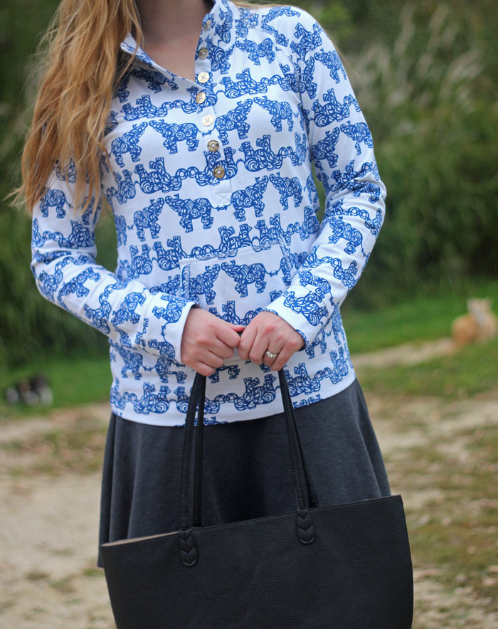 Lilly Pulitzer popover in Resort White Pack Your Trunk, grey swing skirt, OTK boots | Puppies & Pretties