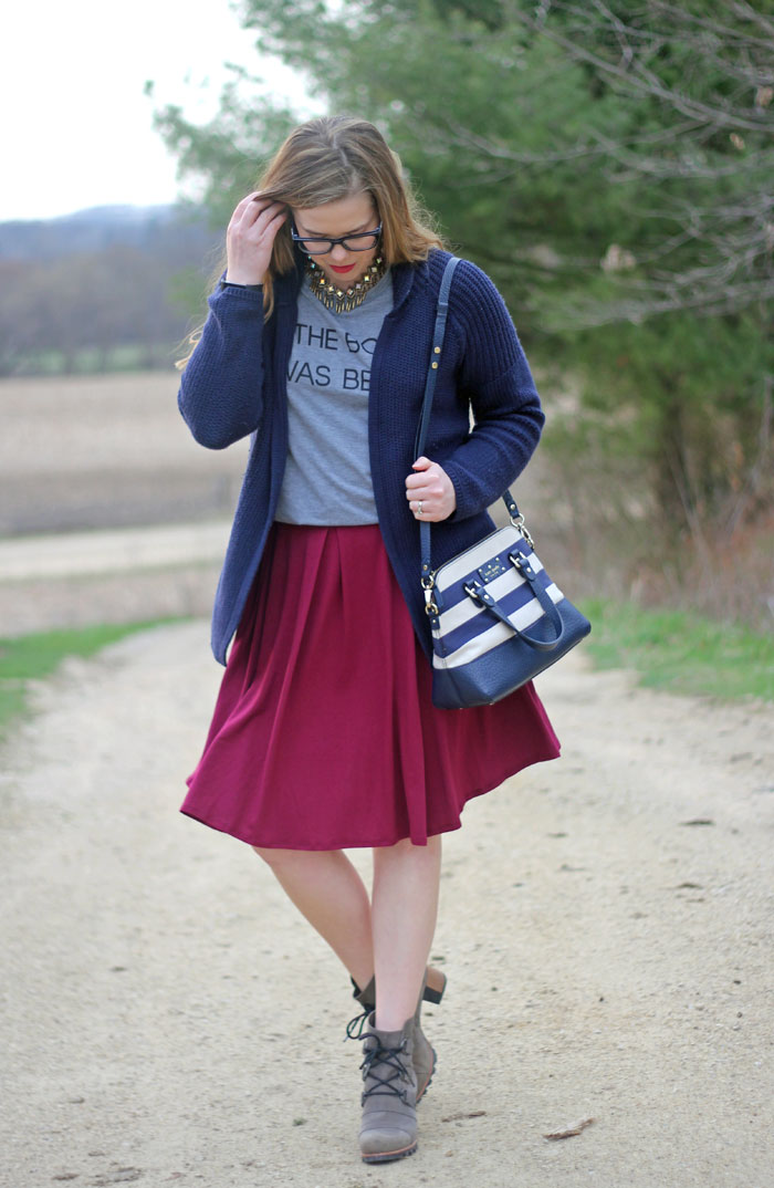 LuLaRoe Madison skirt in maroon, The book was better graphic tee, navy cardigan, Kate Spade striped purse, Sorel Addington lace up booties, Loren Hope necklace | Puppies & Pretties