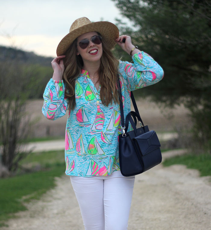 Springtime Brights: Lilly Pulitzer elsa top in You Gotta Regatta, white jeans, gold Vionic flats, Hat Attack hat, Kate Spade bow bag | Puppies & Pretties
