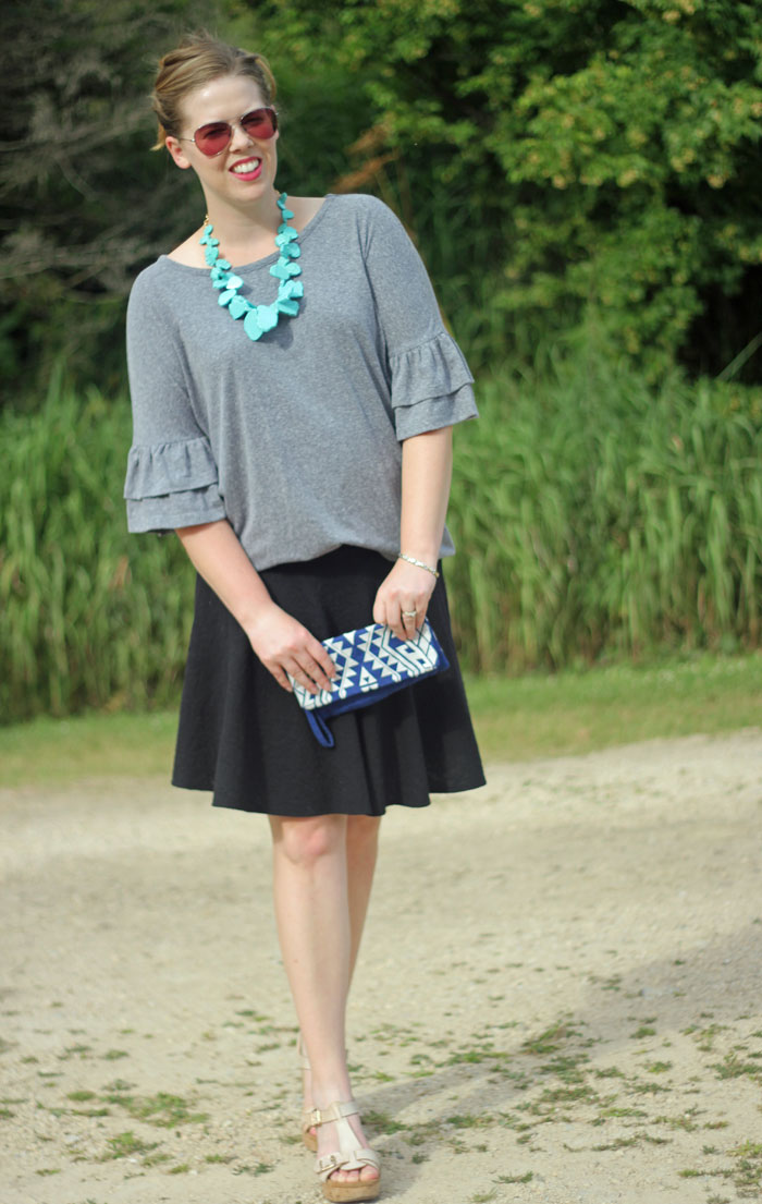 Grey Bell Sleeves: get ready for cooler weather with bell sleeves. Grey bell sleeve top, black swing skirt, BaubleBar seaglass bib necklace in turquoise   Puppies & Pretties