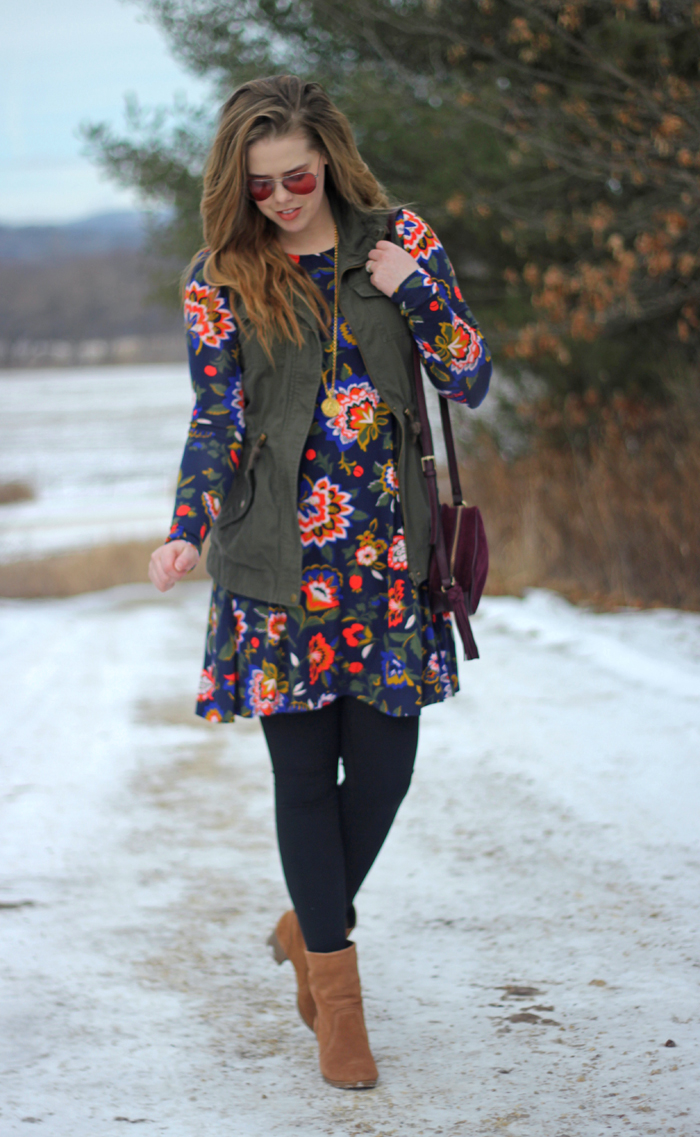 Floral Dress and Utility Vest: Old Navy swing dress in winter floral, green utility vest, black leggings, brown booties, maroon purse, Julie Vos pendant   Puppies & Pretties